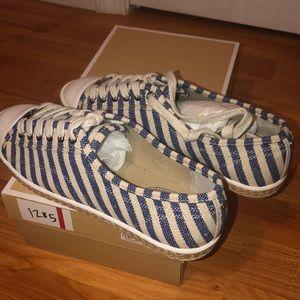 Michael Kors women blue and white striped sneaker.